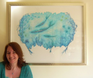 Artist Joy Norman with her handmade paper work, 'Hyone'.